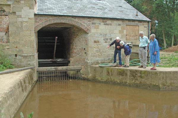 Yorkshire, Howsham; FoGS members watching the waterwheel in oper