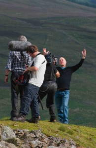 Tony Robinson, filming a piece to camera at Rise Hill