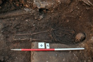 Richard III's remains in situ - copyright University of Leicester