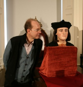 A family resemblance? Michael Ibsen, Richard III's 17th generation nephew, whose DNA provided the key to identifying the king's remains, stands beside the model. Image: M Symonds