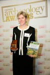 Rebecca Jones, with her award-winning book and prize, as the winner of 2013's Book of the Year at the prestigious Current Archaeology Awards