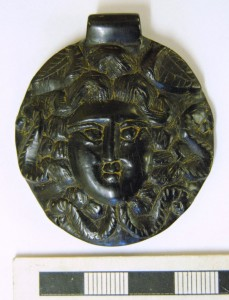 Jet Medusa amulet from the site. Image: Colchester Archaeological Trust