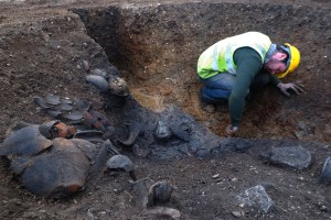 A Roman well and pottery under excavation, part of the 14ha excavation northwest of Cambridge which has revealed extensive Roman settlements, as well as Middle Bronze Age and Iron Age activity. Credit: Dave Webb