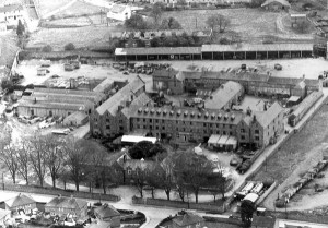 An aerial photograph of the former Kilkenny Union Workhouse complex, taken sometime during the early 1960s. The site of the mass burials is top left of this photo, in the corner of the boundary wall. Credit: Property of Karyn Deegan, published by kind permission via the Local Studies section of Kilkenny County Library.