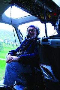 Doing what he loved: flying over archaeological sites in the Time Team helicopter. Photo courtesy Stewart Ainsworth