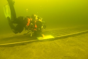 A diver from the National Monuments Service's Underwater Archaeology Unit records a 12m-long Bronze Age logboat at the bottom of Lough Corrib.