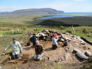 Students in 2015 excavating the interior of a large Middle Bronze Age building. (Photo: Achill Archaeological Field School).